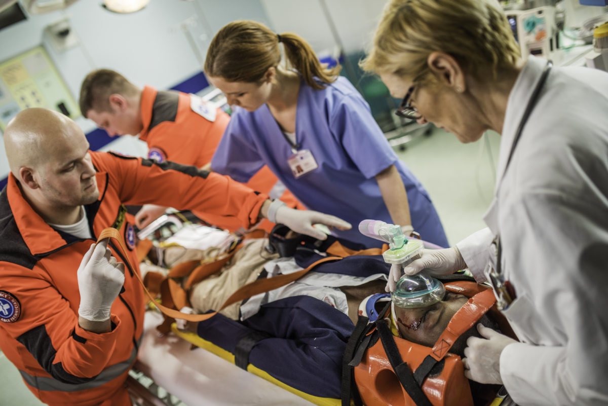 Paramedics and doctors in emergency room